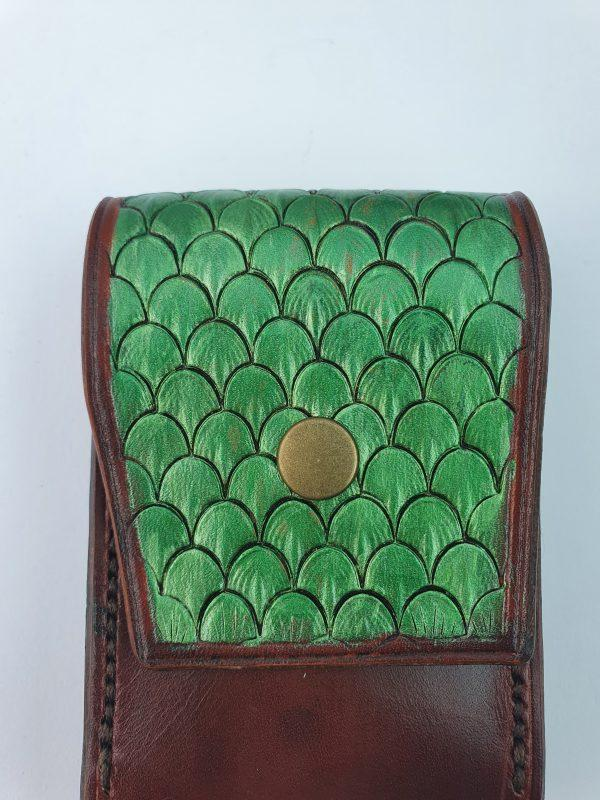 dragon shin tooled leather in green on a brown leather pouch